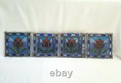 A vintage signed set of four stained glass panels, 1 pair are three dimensional