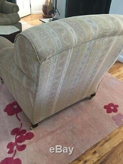 Pair of George Smith armchairs with casters pattern fabric signed cushion seat