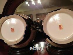 Pair of Japanese Taisho Period Kyo Satsuma Vases on stands. Signed Kusube. C1920
