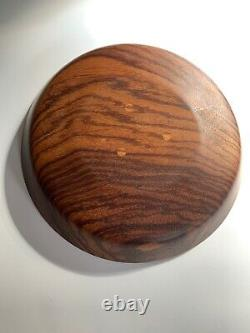 Pair of hand-turned wooden bowls signed W. Frost zebra wood and butternut